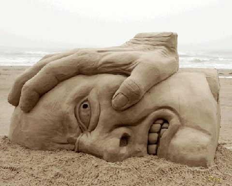Face being pushed in the sand